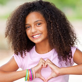 Smiling preteen girl with healthy teeth