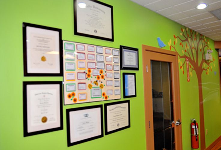 Doctor certificates on wall