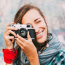 Teen girl with braces taking photo