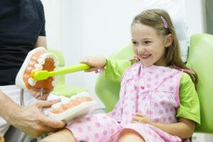 Smiling little girl at the dentist